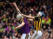 11 March 2018; TJ Reid of Kilkenny gathers possession ahead of Liam Ryan of Wexford during the Allianz Hurling League Division 1A Round 5 match between Kilkenny and Wexford at Nowlan Park in Kilkenny. Photo by Brendan Moran/Sportsfile