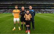 11 March 2018: Allianz Dublin Primary Whistler Seán Hain, St. Paul's NS, Navan, with referee Ciaran Branagan and team captains Shane Murphy of Kerry and Stephen Cluxton of Dublin prior to the Allianz Football League Division 1 Round 5 match between Dublin and Kerry at Croke Park in Dublin. Photo by Stephen McCarthy/Sportsfile