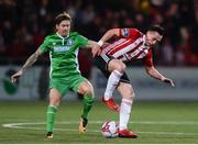 12 March 2018; Aaron McEneff of Derry City in action against Daniel Kearns of Limerick during the SSE Airtricity League Premier Division match between Derry City and Limerick at the Brandywell Stadium in Derry. Photo by Oliver McVeigh/Sportsfile