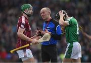 11 March 2018: Referee Cathal McAllister with Adrian Tuohy of Galway and Barry Murphy of Limerick during the Allianz Hurling League Division 1B Round 5 match between Galway and Limerick at Pearse Stadium in Galway. Photo by Diarmuid Greene/Sportsfile