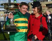 13 March 2018; Jockey Barry Geraghty with his wife Paula after winning the UniBet Champion Hurdle Challenge Trophy with Buveur D'air on Day One of the Cheltenham Racing Festival at Prestbury Park in Cheltenham, England. Photo by Ramsey Cardy/Sportsfile