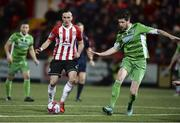 12 March 2018; Aaron McEneff of Derry City in action against Shaun Kelly of Limerick  during the SSE Airtricity League Premier Division match between Derry City and Limerick at Brandywell Stadium, in Derry.  Photo by Oliver McVeigh/Sportsfile