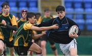 14 March 2018: Harry O'Neill of Dundalk Grammar School is tackled by Stefan San Agustin of CBS Enniscorthy - St Marys during the Duff Cup Final match between CBS Enniscorthy - St Marys and Dundalk Grammar at Donnybrook Stadium in Dublin. Photo by Matt Browne/Sportsfile