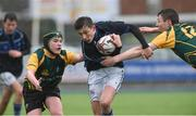 14 March 2018: Woodley Nicholson of Dundalk Grammar School is tackled by James Doyle and Conor Murphy of CBS Enniscorthy - St Marys during the Duff Cup Final match between CBS Enniscorthy - St Marys and Dundalk Grammar at Donnybrook Stadium in Dublin. Photo by Matt Browne/Sportsfile
