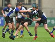 14 March 2018: Mark Kehoe of Gorey Community School is tackled by Jack Hughes and Daniel Molloy of Dundalk Grammar School during the McMullan Cup Final match between Gorey Community School and Dundalk Grammar at Donnybrook Stadium in Dublin. Photo by Matt Browne/Sportsfile