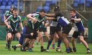 14 March 2018: Jack Ryan of Gorey Community School is tackled by Andrew Cox and Tobi Akinseloyian of Dundalk Grammar School during the McMullan Cup Final match between Gorey Community School and Dundalk Grammar at Donnybrook Stadium in Dublin. Photo by Matt Browne/Sportsfile