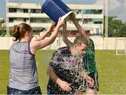 16 March 2018; Cork manager Ephie Fitzgerald is given some refreshment by Ciara Trant of Dublin, left, and Aimee Mackin of Armagh after a training session on the TG4 Ladies Football All-Star Tour 2018. Berkeley International School. Bangkok, Thailand. Photo by Piaras Ó Mídheach/Sportsfile