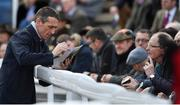 16 March 2018; Jockey Davy Russell signs autographs during Day Four of the Cheltenham Racing Festival at Prestbury Park in Cheltenham, England. Photo by Ramsey Cardy/Sportsfile