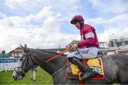 16 March 2018; Jockey Jack Kennedy celebrates after winning the JCB Triumph Hurdle on Farclas during Day Four of the Cheltenham Racing Festival at Prestbury Park in Cheltenham, England. Photo by Ramsey Cardy/Sportsfile