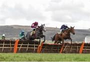 16 March 2018; Farclas, left, with Jack Kennedy up, who finished first, jumps the last ahead of eventual second place finisher Mr Adjudicator, with Paul Townend up, during the JCB Triumph Hurdle on Day Four of the Cheltenham Racing Festival at Prestbury Park in Cheltenham, England. Photo by Seb Daly/Sportsfile