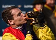 16 March 2018; Jockey Richard Johnson celebrates with the Gold Cup after winning the Timico Cheltenham Gold Cup Steeple Chase on Native River on Day Four of the Cheltenham Racing Festival at Prestbury Park in Cheltenham, England. Photo by Seb Daly/Sportsfile