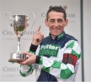 16 March 2018; Leading jockey of the 2018 Cheltenham Festival Davy Russell celebrates with the cup during Day Four of the Cheltenham Racing Festival at Prestbury Park in Cheltenham, England. Photo by Seb Daly/Sportsfile