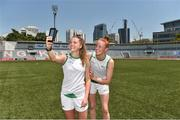 17 March 2018; Sarah Rowe of Mayo, left, and Aishling Moloney of Tipperary take a selfie before the 2016 All-Stars v 2017 All-Stars Exhibition match during the TG4 Ladies Football All-Star Tour 2018. Chulalongkorn University Football Club Stadium, Bangkok, Thailand. Photo by Piaras Ó Mídheach/Sportsfile