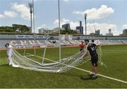 17 March 2018; Members of Thailand GAA put up the goalnets before the 2016 All-Stars v 2017 All-Stars Exhibition match during the TG4 Ladies Football All-Star Tour 2018. Chulalongkorn University Football Club Stadium, Bangkok, Thailand. Photo by Piaras Ó Mídheach/Sportsfile