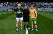 17 March 2018: Referee David Gough with Aidan O'Reilly of Nemo Rangers and Ciarán McGrath of Corofin prior to the AIB GAA Football All-Ireland Senior Club Championship Final match between Corofin and Nemo Rangers at Croke Park in Dublin. Photo by Stephen McCarthy/Sportsfile