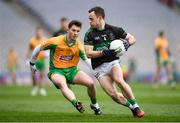 17 March 2018: Alan Cronin of Nemo Rangers in action against Ian Burke of Corofin during the AIB GAA Football All-Ireland Senior Club Championship Final match between Corofin and Nemo Rangers at Croke Park in Dublin. Photo by Stephen McCarthy/Sportsfile