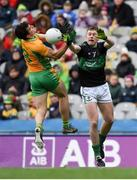 17 March 2018: Daithí Burke of Corofin competes a high ball against Alan O'Donovan of Nemo Rangers during the AIB GAA Football All-Ireland Senior Club Championship Final match between Corofin and Nemo Rangers at Croke Park in Dublin. Photo by David Fitzgerald/Sportsfile
