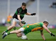 17 March 2018: Gary Sice of Corofin is tackled by Kevin O'Donovan of Nemo Rangers during the AIB GAA Football All-Ireland Senior Club Championship Final match between Corofin and Nemo Rangers at Croke Park in Dublin. Photo by Eóin Noonan/Sportsfile