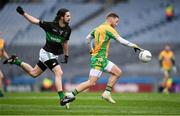 17 March 2018: Micheál Lundy of Corofin in action against Kevin Fulignati of Nemo Rangers during the AIB GAA Football All-Ireland Senior Club Championship Final match between Corofin and Nemo Rangers at Croke Park in Dublin. Photo by Stephen McCarthy/Sportsfile