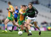 17 March 2018: Michael Dorgan of Nemo Rangers is tackled by Daithí Burke of Corofin during the AIB GAA Football All-Ireland Senior Club Championship Final match between Corofin and Nemo Rangers at Croke Park in Dublin. Photo by Eóin Noonan/Sportsfile