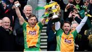 17 March 2018: Corofin joint captains Ciarán McGrath, left, and Micheál Lundy lift the Andy Merrigan Cup following the AIB GAA Football All-Ireland Senior Club Championship Final match between Corofin and Nemo Rangers at Croke Park in Dublin. Photo by David Fitzgerald/Sportsfile