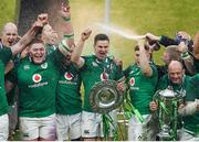17 March 2018; Ireland players, from left, Devin Toner, Tadhg Furlong, Jacob Stockdale, Cian Healy, Jonathan Sexton, Jordan Larmour and Rory Best  celebrate with the Six Nations and Triple Crown trophies after the NatWest Six Nations Rugby Championship match between England and Ireland at Twickenham Stadium in London, England. Photo by Harry Murphy/Sportsfile