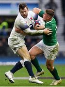 17 March 2018; Elliot Daly of England is tackled by Jordan Larmour of Ireland during the NatWest Six Nations Rugby Championship match between England and Ireland at Twickenham Stadium in London, England. Photo by Ramsey Cardy/Sportsfile