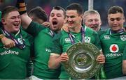 17 March 2018; Ireland players, from left, Tadhg Furlong, Cian Healy, Jonathan Sexton and Jordan Larmour celebrate with the Triple Crown trophy after the NatWest Six Nations Rugby Championship match between England and Ireland at Twickenham Stadium in London, England. Photo by Brendan Moran/Sportsfile