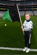 17 March 2018: AIB flagbearer Ebany Crotty, age 9, who won an AIB flag bearer competition to wave on Nemo Rangers sat the AIB Senior Football Club Championship Final between Corofin and Nemo Rangers at Croke Park on St. Patrick's Day. For exclusive content and behind the scenes action of the AIB GAA & Camogie Club Championships follow AIB GAA on Facebook, Twitter, Instagram and Snapchat and www.aib.ie/gaa. Photo by Stephen McCarthy/Sportsfile