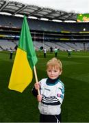 17 March 2018: AIB flagbearer Evan O'Sullivan, age 8, who won an AIB flag bearer competition to wave on Corofin sat the AIB Senior Football Club Championship Final between Corofin and Nemo Rangers at Croke Park on St. Patrick's Day. For exclusive content and behind the scenes action of the AIB GAA & Camogie Club Championships follow AIB GAA on Facebook, Twitter, Instagram and Snapchat and www.aib.ie/gaa. Photo by Stephen McCarthy/Sportsfile