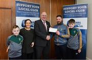 17 March 2018: Gerry Redmond and Ciaran Redmond, with their family from Sean O'Mahony's GAA, Louth, receiving the fourteenth prize, All Ireland hurling premium package, from Uachtarán Chumann Lúthchleas Gael John Horan during the presentation of prizes to the winners of the GAA National Club Draw at Croke Park in Dublin. Photo by Eóin Noonan/Sportsfile