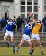 18 March 2018; John Dillon of Antrim in action against Patrick Purcell and Ross King of Laois during the Allianz Hurling League Division 1B Relegation Play-Off match between Antrim and Laois at Pearse Park in Dunloy, Co Antrim. Photo by Mark Marlow/Sportsfile