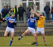 18 March 2018; John Dillon of Antrim in action against Patrick Purcell, left, and Ross King of Laois during the Allianz Hurling League Division 1B Relegation Play-Off match between Antrim and Laois at Pearse Park in Dunloy, Co Antrim. Photo by Mark Marlow/Sportsfile