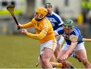 18 March 2018; Conor Johnston of Antrim in action against Charles Dwyer of Laois during the Allianz Hurling League Division 1B Relegation Play-Off match between Antrim and Laois at Pearse Park in Dunloy, Co Antrim. Photo by Mark Marlow/Sportsfile