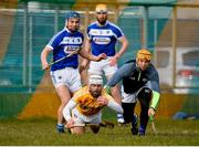 18 March 2018; Neil McManus of Antrim in action against Lee Cleere, left, and Enda Rowland of Laois during the Allianz Hurling League Division 1B Relegation Play-Off match between Antrim and Laois at Pearse Park in Dunloy, Co Antrim. Photo by Mark Marlow/Sportsfile
