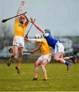 18 March 2018; Simon McCrory, left, and Paddy Burke of Antrim in action against Willie Dunphy of Laois during the Allianz Hurling League Division 1B Relegation Play-Off match between Antrim and Laois at Pearse Park in Dunloy, Co Antrim. Photo by Mark Marlow/Sportsfile