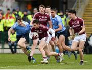 18 March 2018; Damien Comer of Galway makes a break from Emmet O'Conghaile, left, and James McCarthy of Dublin during the Allianz Football League Division 1 Round 6 match between Galway and Dublin at Pearse Stadium, in Galway. Photo by Ray Ryan/Sportsfile