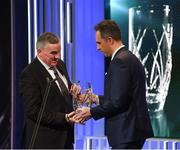 18 March 2018; Karl Donnelly, Head of Sponsorship at 3 Ireland, presents Mark Magee, son of the late broadcaster Jimmy Magee, with the Special Merit award during the 3 FAI International Awards at RTE Studios in Donnybrook, Dublin. Photo by Stephen McCarthy/Sportsfile