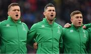 17 March 2018; Ireland players, from left, Andrew Porter, Rob Kearney and Jordan Larmour stand for the national anthem prior to the NatWest Six Nations Rugby Championship match between England and Ireland at Twickenham Stadium in London, England. Photo by Brendan Moran/Sportsfile