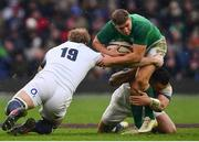 17 March 2018; Jordan Larmour of Ireland is tackled by Ben Te'o, left, and Joe Launchbury of England during the NatWest Six Nations Rugby Championship match between England and Ireland at Twickenham Stadium in London, England. Photo by Ramsey Cardy/Sportsfile