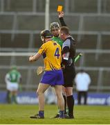 19 March 2018; Gearoid Hegarty of Limerick and Jack Browne of Clare are each shown a yellow card by referee Alan Kelly during the Allianz Hurling League Division 1 quarter-final match between Limerick and Clare at the Gaelic Grounds in Limerick. Photo by Diarmuid Greene/Sportsfile