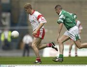 3 August 2003; Kevin Hughes, Tyrone, in action against Fermanagh's Neil Cox. Bank of Ireland All-Ireland Senior Football Championship Quarter Final, Tyrone v Fermanagh, Croke Park, Dublin. Picture credit; Brendan Moran / SPORTSFILE *EDI*