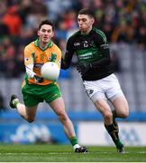 17 March 2018: Ian Burke of Corofin in action against Luke Connolly of Nemo Rangers during the AIB GAA Football All-Ireland Senior Club Championship Final match between Corofin and Nemo Rangers at Croke Park in Dublin. Photo by Stephen McCarthy/Sportsfile