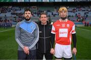 17 March 2018: Referee Colm Lyons with Cathal King of Na Piarsaigh and Paul Schutte of Cuala during the AIB GAA Hurling All-Ireland Senior Club Championship Final match between Cuala and Na Piarsaigh at Croke Park in Dublin. Photo by Stephen McCarthy/Sportsfile