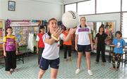 20 March 2018; Galway's Sinéad Burke giving a coaching lesson to orphans as Cork's Bríd Stack looks on during a visit to Sister Horgan who is an Irish missionary, originally from Cork, and third cousin to eleven-time All-Ireland Ladies Senior Football title winner Briege Corkery of Cork. She is the founder of the Good Shepherd Sisters in Bangkok that run the Fatima Centre, where she has been working with disadvantaged local people, orphans and migrants for over fifty years. Helping them to gain an education along with work and life skills. Pictured during the TG4 Ladies Football All-Star Tour 2018 in Bangkok, Thailand. Photo by Piaras Ó Mídheach/Sportsfile