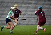 24 March 2018; Sinead Cannon of Sarsfields scoring her side's first goal against Jolene Bradley of Slaughtneil during the AIB All-Ireland Senior Club Camogie Final match between Sarsfields and Slaughtneil at St Tiernach's Park in Clones, Monaghan. Photo by Oliver McVeigh/Sportsfile