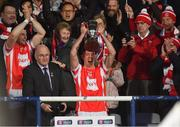 24 March 2018; Cuala captain Paul Schutte lifts the Tommy Moore Cup in the company of GAA President John Horan after the AIB GAA Hurling All-Ireland Senior Club Championship Final replay match between Cuala and Na Piarsaigh at O'Moore Park in Portlaoise, Laois. Photo by Piaras Ó Mídheach/Sportsfile
