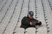 25 March 2018; A Dublin supporter reads his programme prior to the Allianz Hurling League Division 1 Quarter-Final match between Dublin and Tipperary at Croke Park in Dublin. Photo by Stephen McCarthy/Sportsfile