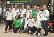 25 March 2018; Irish Masters team members, from left, Team Manager Anne Gormley, Ian Egan, Robert Maher, Joe Gough, Patrick Malone, Maggie O'Connor, Bríd Lawlor, front row, Aishling Smith, Michelle Kenny, Jackie Carthy and Team captain Ronan Kearns, on their arrival at Dublin Airport after a successful week competing at the European Masters Indoor Track & Field Championships in Madrid, at Dublin Airport in Dublin. Photo by Tomás Greally/Sportsfile