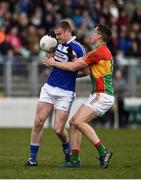 25 March 2018; Donal Kingston of Laois in action against Brendan Murphy of Carlow during the Allianz Football League Division 4 Round 7 match between Carlow and Laois at Netwatch Cullen Park in Carlow. Photo by Seb Daly/Sportsfile